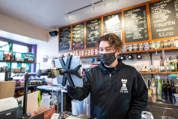 Kyle Kornic, founder of The Rook, works the checkout at his other business, Brew Wizards