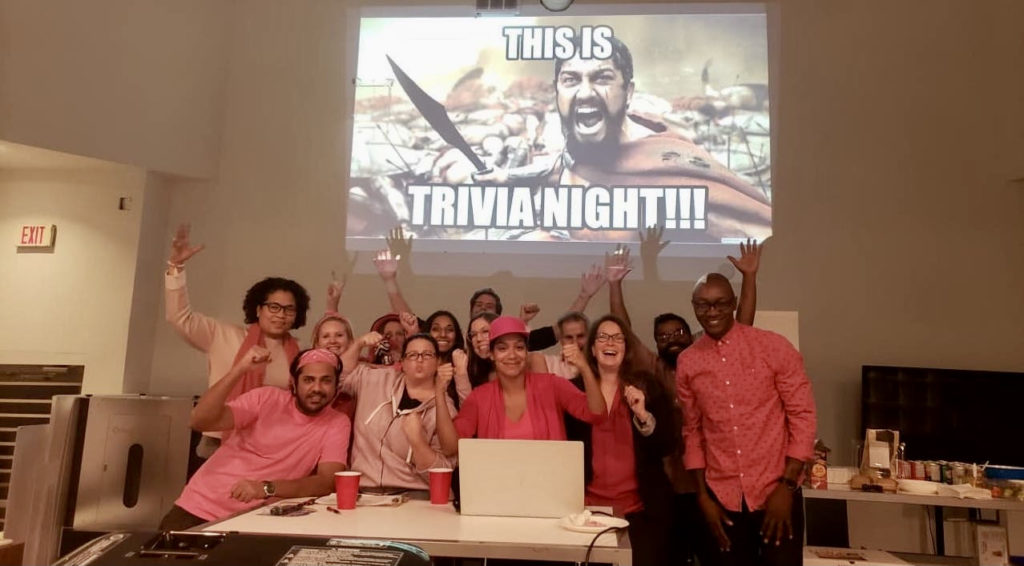 Photo of the geekSpeak Commerce team at their trivia night fundraiser for breast cancer research.